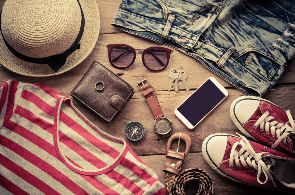 clothes, shoes, hat, sunglasses on floor, preparing for weekend getaway with sickle cell anemia