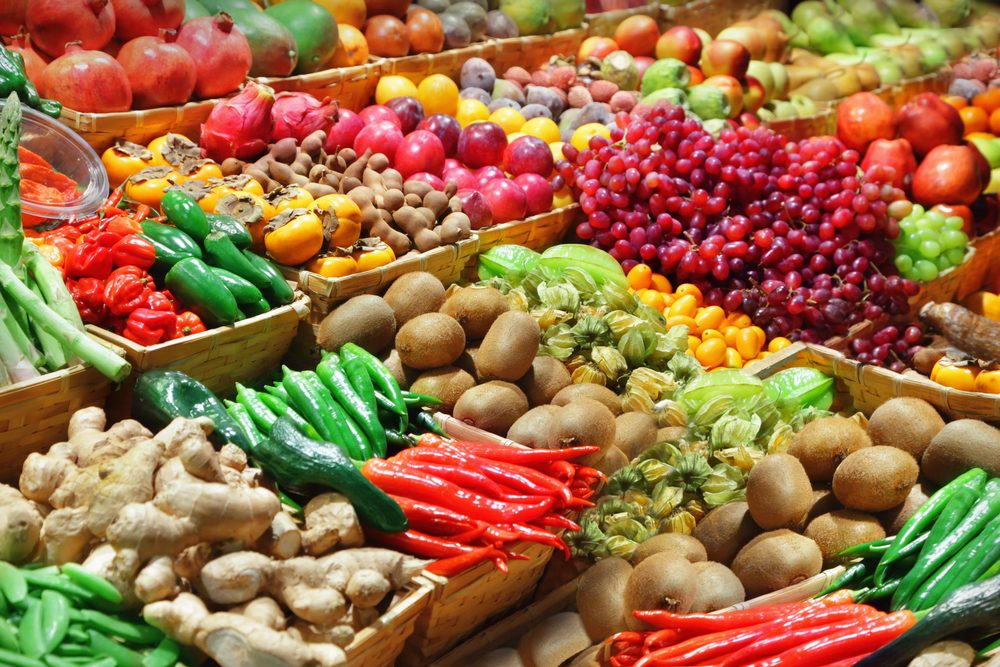 vegan diet   Sickle Cell Disease News   An array of colorful fruits and vegetables in the produce section of a supermarket