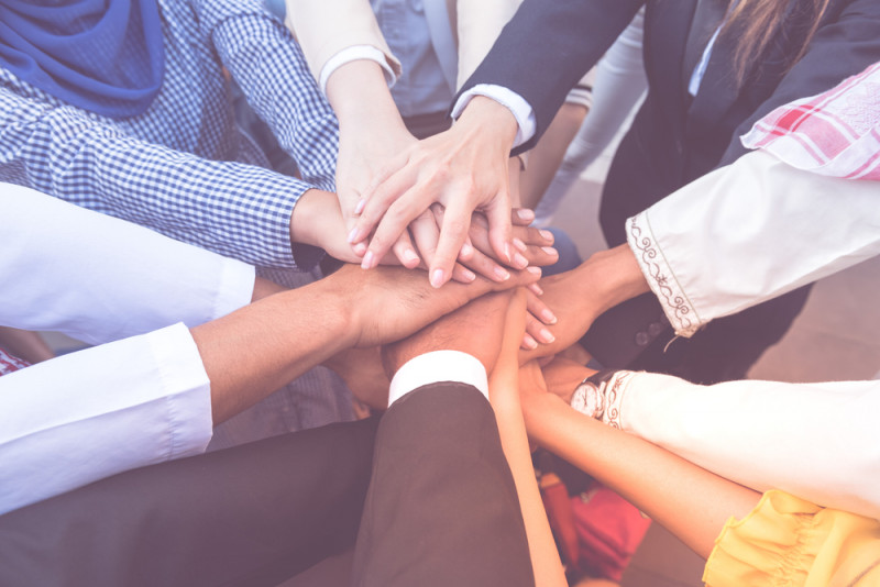 education and awareness   Sickle Cell Disease News   Awareness Campaigns   Many hands placed on top of each other in a huddle